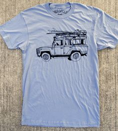 Inspired by the mountains and the seaside, the truck on this comfy tee represents both outdoorsy destinations. The land roving vehicle is illustrated in bold black outlines on a light blue t-shirt, fitted with a rack for surfboards and geared up for trekking through rough terrain. Screenprinted on a fitted preshrunk tee, the design will only look better when worn with your favorite pair of jeans and exploring gear.