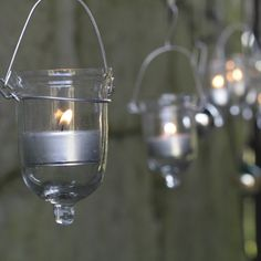 Fire Fly T-Lights (Set of These charming T-light holders look beautiful strung from tree branches or across a table. Their delicate size and shape enhance the soft flicker of the candle light. Glass Tea Light Holders, Candle Holders, Hanging Tea Lights, Hanging Lanterns, Handmade Lanterns, T Lights, Glass Vessel, Glass Candle, Mason Jar Wine Glass