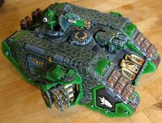 Warhammer 40k, Space Marines. Salamanders Chapter Land Raider with some great custom decorations (although why it's a Crusader and not a Redeemer...)