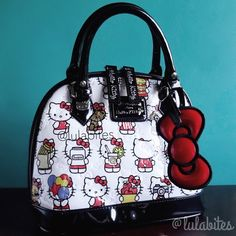 """Sale  Hello Kitty Foodie Handbag Adorable bag perfect for Hello Kitty foodie fans. Item is by Loungefly X Hello Kitty. Specifications: - 8.25""""H x 9""""W x 4.5""""D - 3.5"""" drop length - Patent PVC leather purse with embossed print, black polyester lining - Double zipper closure with cursive script Hello Kitty tags - 2 regular pockets and 1 zip pocket inside - Silvertone Hello Kitty rivets, Loungefly loves Hello Kitty metal nameplate and studded base. Wallet sold separately. Hello Kitty Bags…"""
