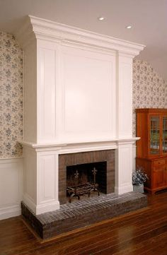 Moulding over fireplace Fireplace Frame, Fake Fireplace, Brick Fireplace Makeover, Fireplace Surrounds, Fireplace Design, Electric Fireplace, Fireplace Ideas, White Wood Paneling, Sweet Home Design
