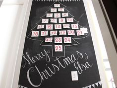 Pretty, Festive DIY Chalkboard Advent Calendar >> http://blog.diynetwork.com/maderemade/2013/11/26/diy-chalkboard-advent-wall-calendar?soc=pinterest