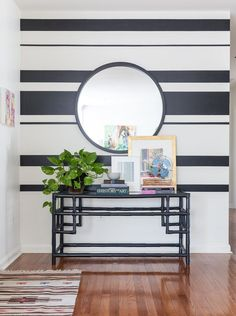 The painted stripes give this wall of the entryway a bold touch.