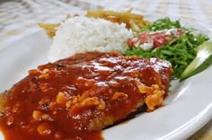 Grilled fish with a red seafood sauce La Perla del Sur Restaurant Sierpe, Costa Rica #food #foodie #travel