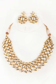 Gold Finish Kundan Choker And Earrings by Parul Kapoor. Shop now…
