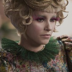 "Physical description. ""Effie Trinket ..."