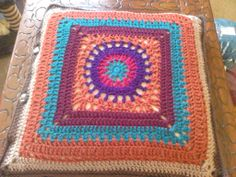 circle in square pattern - colours chosen to blend with my cross stitch cushions Pattern is http://www.ravelry.com/patterns/library/circle-in-the-square-pillows