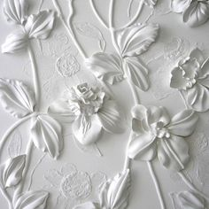 Wow! Wall art by Olefir Design.  Something similar to this can be made by gluing silk flowers to a canvas and spray painting it white.  You can also draw out designs around the flowers with glue before painting.