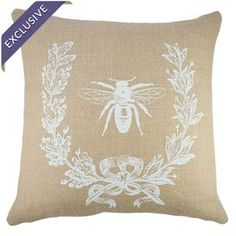 """Burlap pillow showcasing a vintage-inspired French typography motif. Handmade in the USA.    Product: PillowConstruction Material: Burlap coverColor: Beige and whiteFeatures:  Zipper enclosure Insert includedHandmade by TheWatsonShop  Dimensions: 16"""" x 16""""Cleaning and Care: Spot clean"""