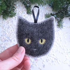 Handmade Christmas ornament - felt cat ornament - handcrafted from 100% wool felt - Christmas and Holiday decor by StillLifeHome on Etsy https://www.etsy.com/listing/253190024/handmade-christmas-ornament-felt-cat