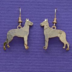 Our exclusive Great Dane earrings are cut from brass from a refined master computer aided design. The earwires are 14k Gold Filled.The entire product is made in the USA. Each piece is hand shaped and