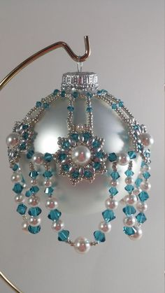 Oh My Stars is made with Swarovski crystals, Swarovski pearls, super duos and silver seed beads.