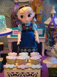 Elsa doll, cupcakes and cookies at a Frozen birthday party! See more party planning ideas at CatchMyParty.com!