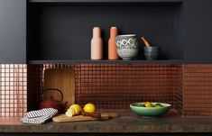 Decorating a Small Kitchen by Cote MaisonCopper tile looks incredible with beloved copper cookware, and it really pops against black walls. Copper Backsplash, Kitchen Backsplash, Kitchen Interior, Kitchen Decor, Living Room Designs, Living Room Decor, Copper Kitchen, Black Walls, Black Kitchens