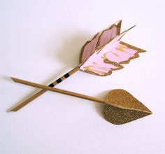 Cupids Arrow cake topper decoration shown in gold pink.