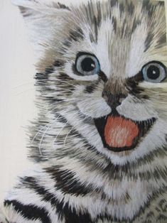 Joyful kitten. Can you believe this is silk shading embroidery? Masterful.