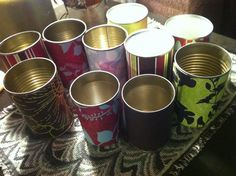 Old vegetable cans wrapped in scrap book paper