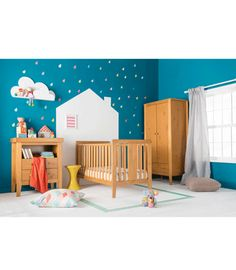 Feature wall in the nursery. When the poor nipper actually gets his own room...