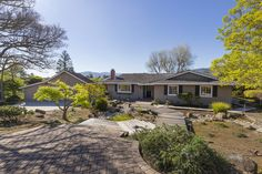 Welcome to 18632 Woodbank Wy in Saratoga, CA. The lovely ranch style house makes full use of views of the verdant 1.37 acres it sits on and the expansive nearby hills.