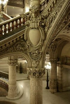 Elaborate cartouche stationed between column and balustrade.