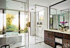 Designer Waldo Fernandez's Beverly Hills master bath is sheathed in Calacatta marble.  DESIGNER: Waldo's Designs PHOTOGRAPHER: Roger Davies HOMEOWNER: Waldo Fernandez ARTICLE: A Gimlet Eye, April 2013 LOCATION: Los Angeles, California