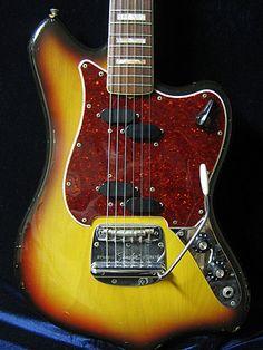 Fender Maverick or Custom