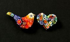 Hanmade brooches from Italian glass beads. Each one is hand crafted and set purposely in a specific way to enhance the colours and design of the brooches.#womens #fashion #brooches #bird #heart #