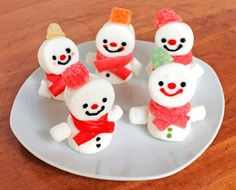 These Snowman Marshmallow Treats are button cute and the kids will love to help make them this Christmas!