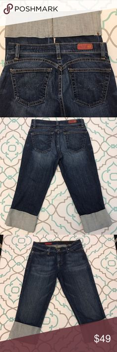 """💙👖Super Cute Cuffed AG Capris👖💙28 5/6 19"""" Dark 💙👖Super Cute AG Cuffed Capri Jeans👖💙 Size 28 (5/6). 19.25"""" Inseam. 8"""" Rise. 14.5"""" Across the Back. Tag removed. Please See and Compare measurements with your own pants that fit! I'm fairly certain these are a 28 based on measurements of other AG jeans. ; ) No fabric content. Awesome Stretch. Dark Wash. Light Fading. Adriano Goldschmied. The Shorty. Excellent Used Condition. Cute Details! Curved Yoke seams above Back Pockets. Sewn…"""