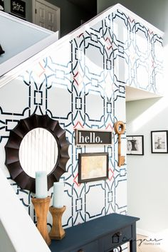 Stencil a pattern you love to create a custom accent wall.