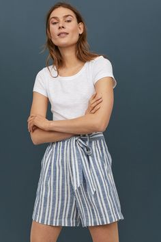 2e37f694ccbe Striped shorts in woven fabric made from a linen and viscose blend with a  paper-bag waist and tie belt. Pleats at front, zip fly, side pockets, and  mock bac