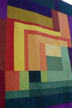 Solids in tropical colors / Modified log cabin quilt top.  LOVE