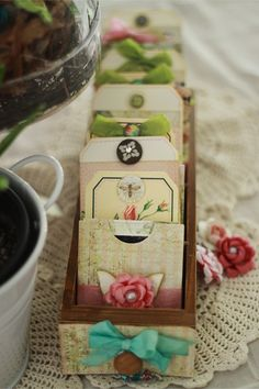 mini drawer full of favorite photos with embellished tags, pockets and little envelopes by Suzanne Tonga