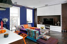 Gorgeous and colorful modular sofa by Roche Bobois sits at the heart of the home theatre guest room