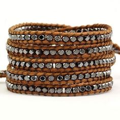 Victoria Emerson 5-Wrap Bracelet on light brown leather with gun-metal fragments. 100% hand made with care. This bracelet is made with a natural color leather. It may appear lighter when you first rec
