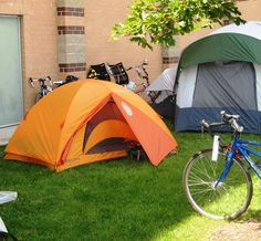 Bivy tent used by cyclist during SAGRAW, the annual bicycle ride through Wisconsin. Camping is in small towns on school grounds.