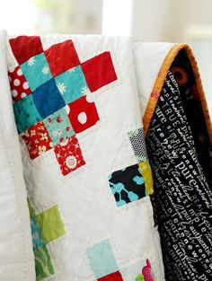 Blue Elephant Stitches: Granny Square Quilt Block Tutorial - A cute scrappy design that would work great with pre-cut jelly rolls or mini charms! Fabric Shack has a large selection of pre-cuts available at http://www.fabricshack.com/cgi-bin/Store/store.cgi