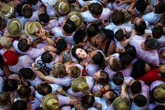 """Revelers crowd together on the opening day or """"Chupinazo"""" of the San Fermin Running of the Bulls fiesta on July 6, 2015, in Pamplona, Spain."""