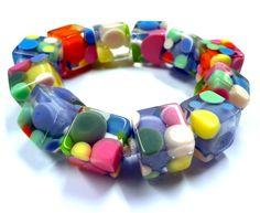 Pom pom link resin bracelet. #handmade #jewelry #DIY   http://liloveve.com/jewelry-school/classes/resin/