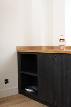 Rough sawn timber cupboards stained with an 'inky blue-black' dye