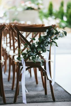 Eucalyptus wrapped wedding seats: http://www.stylemepretty.com/canada-weddings/british-columbia/whistler/2016/11/23/cozy-rustic-lodge-wedding/ Photography: Lucida - http://lucida-photography.com/