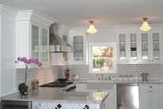 Traditional Kitchen with Ms international - turkish carrara white, Flat panel cabinets, Partial overlay face frame cabinets Shaker Style Cabinets, Grey Kitchen Cabinets, Subway Tile Kitchen, Farmhouse Sink Kitchen, Face Frame Cabinets, Gray And White Kitchen, Open Concept Home, Beach Kitchens, Traditional Kitchen