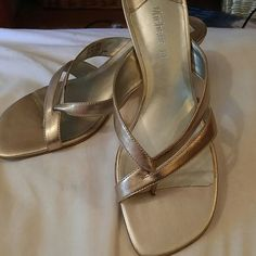Gold leather dressy sandals size 6.5 Leather upper made in Brazil. These were definitely well loved. Just beautiful but my foot is too big as I'm really a 7 Michelle D Shoes Sandals
