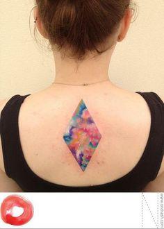 tatt00edpe0ple:  Ondrash tattoo. Watercolor, diamond, back tattoo. I like that it's like a window to the wonder inside.