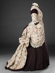 More photos...Late 1870s floral and eggplant colored (aubergine?)polonaise bustle dress. john bright collection