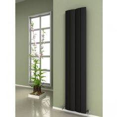 Unusual and quirky, this Evago Black Aluminium Column Designer Towel Rail is a minimalists dream, simple and bold, a real style statement.