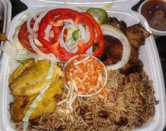 Griot, fried plantains, vegetable rice and pikliz. Haitian ...