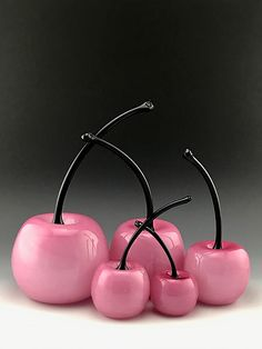 Pink is the New Red by Donald Carlson. Handblown glass cherry in pink with black stem. Sold individually.