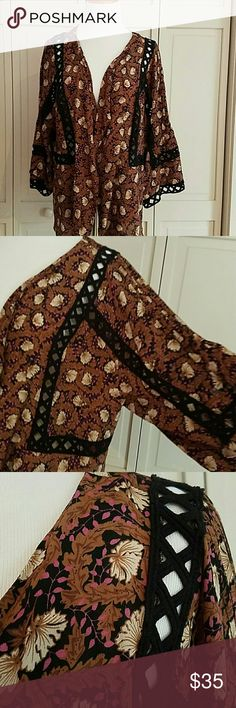 Anthropologie Kimono Jacket Interesting print with cut out black embroidered detail. Size L. Never worn. Jackets & Coats