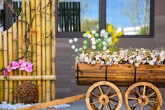 This gorgeous model is made from barrels finished with a deep wood stain. The black from the rings around the barrel offer great color complexity as the brightly colored flowers pop out the tops of the planters. The wooden wheels are also a great addition to this wheelbarrow since they are the exact same color as the body of the planter. This planter definitely looks more chic than vintage, but would be perfect in a vintage themed party or wedding.